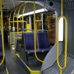 Stanchions in the articulation joint, rear-facing seats on the middle wheel well
